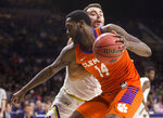 Clemson's Elijah Thomas (14) gets pressure from Notre Dame's John Mooney during the first half of an NCAA college basketball game Wednesday, March 6, 2019, in South Bend, Ind. (AP Photo/Robert Franklin)