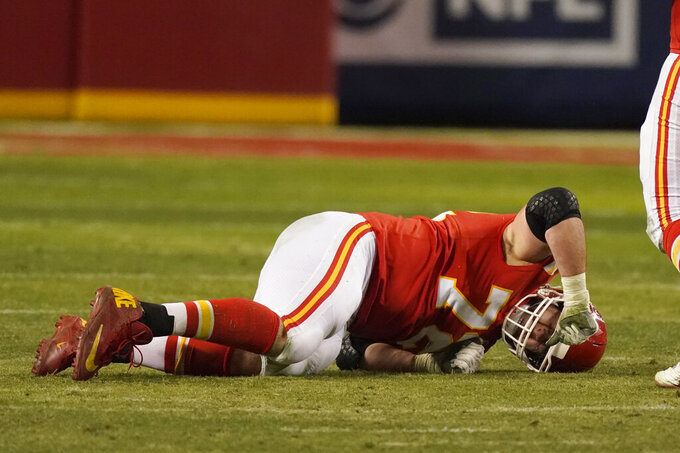 Kansas City Chiefs offensive tackle Eric Fisher reacts after getting injured during the second half of the AFC championship NFL football game against the Buffalo Bills, Sunday, Jan. 24, 2021, in Kansas City, Mo. (AP Photo/Charlie Riedel)