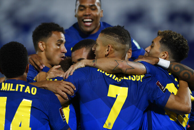 Players of Brazil celebrate their side's opening goal scored by teammate Neymar during a qualifying soccer match for the FIFA World Cup Qatar 2022 against Paraguay at Defensores del Chaco stadium in Asuncion, Paraguay, Tuesday, June 8, 2021. (AP Photo/Jorge Saenz)