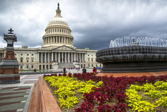 FILE- In this May 30, 2018, file photo the East Front of the U.S. Capitol in Washington is seen under stormy skies. The federal government piled up a record deficit in April, traditionally a month of big budget surpluses. The sea of red ink is being created by a drop in revenue and a massive increase in spending to fund efforts to deal with the coronavirus pandemic. The Treasury Department said Tuesday, May 12, 2020 that the government racked up a shortfall of $737.9 billion last month. That was more than three times larger than the previous record monthly deficit of $235 billion set in February. (AP Photo/J. Scott Applewhite, File)