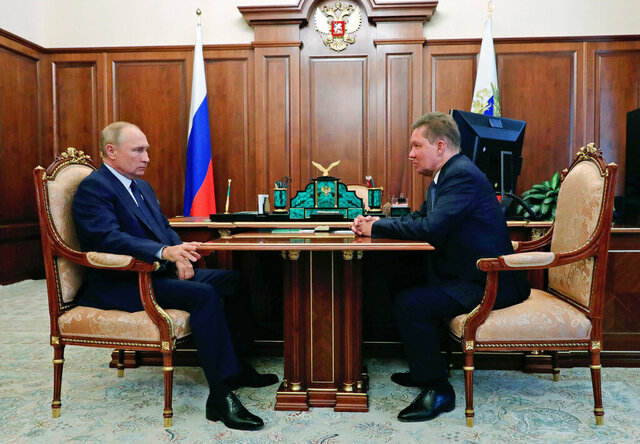 Russian President Vladimir Putin, left, listens to Russian gas monopoly Gazprom Head, Alexei Miller during their meeting in Moscow, Russia, Wednesday, Sept. 16, 2020. (Mikhail Klimentyev, Sputnik, Kremlin Pool Photo via AP)