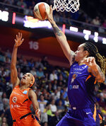 Phoenix Mercury center Brittney Griner, right, block the shot of Connecticut Sun guard Jasmine Thomas during the first half of WNBA basketball game Friday, July 12, 2019, in Uncasville, Conn. (Sean D. Elliot/The Day via AP)
