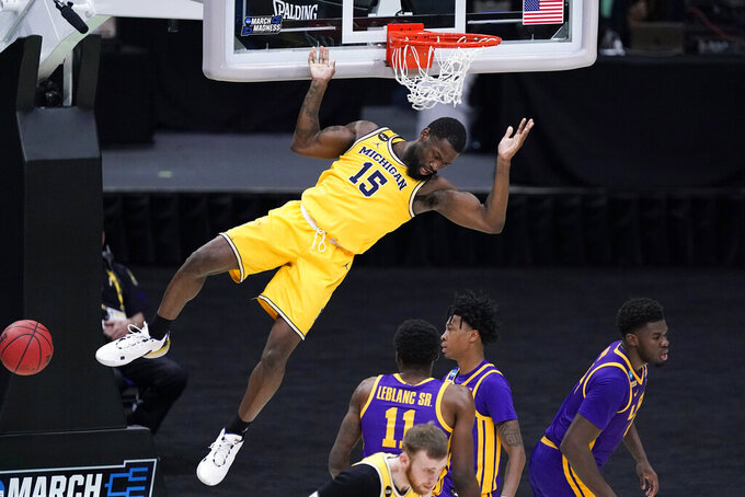 Michigan guard Chaundee Brown (15) dunks the ball during the second half of a second-round game against LSU in the NCAA men's college basketball tournament at Lucas Oil Stadium Monday, March 22, 2021, in Indianapolis. (AP Photo/Darron Cummings)
