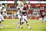 Arkansas running back Raheim Sanders (5) powers past Texas defender B.J. Foster (25) to score a touchdown during the second half of an NCAA college football game Saturday, Sept. 11, 2021, in Fayetteville, Ark. (AP Photo/Michael Woods)