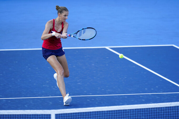 Karolina Pliskova, of the Czech Republic, returns to Camila Giorgi, of Italy, during the third round of the women's tennis competition at the 2020 Summer Olympics, Tuesday, July 27, 2021, in Tokyo, Japan. (AP Photo/Patrick Semansky)