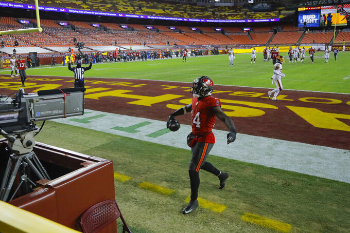 Tampa Bay Buccaneers wide receiver Chris Godwin (14) celebrates his touchdown against the Washington Football Team during the first half of an NFL wild-card playoff football game, Saturday, Jan. 9, 2021, in Landover, Md. (AP Photo/Julio Cortez)