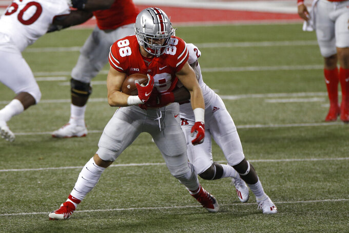 Rutgers defensive back Avery Young, rear, tackles Ohio State tight end Jeremy Ruckert during the first half of an NCAA college football game Saturday, Nov. 7, 2020, in Columbus, Ohio. (AP Photo/Jay LaPrete)