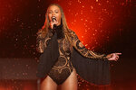 "FILE - In this June 26, 2016, file photo, Beyonce performs ""Freedom"" at the BET Awards in Los Angeles. When Beyonce performed at Coachella in 2018 her high-energy set included the song ""Lift Every Voice and Sing,"" known as the Black national anthem. The Black national anthem was born more than a century ago, but the popular hymn within the African American community called ""Lift Every Voice and Sing"" has been resurrected as a beacon of hope for all races during nationwide protests. (Photo by Matt Sayles/Invision/AP, File)"