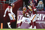 Washington Redskins wide receiver Terry McLaurin (17) celebrates his touchdown with teammates wide receiver Cam Sims (89) and Dwayne Haskins (7) in the first half of an NFL football game against the Philadelphia Eagles, Sunday, Dec. 15, 2019, in Landover, Md. (AP Photo/Alex Brandon)