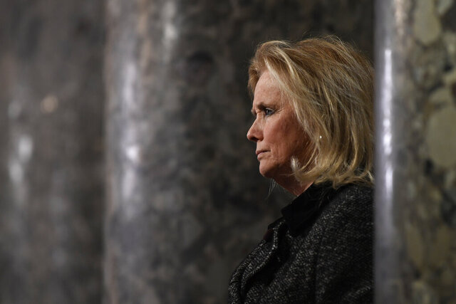 Rep. Debbie Dingell, D-Mich, speaks to reporters on Capitol Hill in Washington, Wednesday, Dec. 18, 2019. (AP Photo/Susan Walsh)