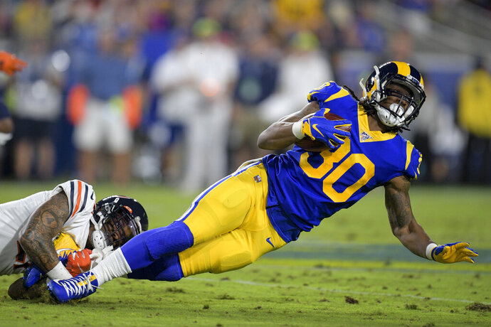 Los Angeles Rams running back Todd Gurley is tackled by Chicago Bears strong safety Ha Ha Clinton-Dix during the first half of an NFL football game Sunday, Nov. 17, 2019, in Los Angeles. (AP Photo/Kyusung Gong)
