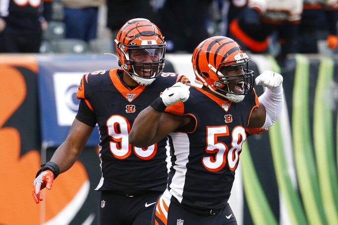 Cincinnati Bengals defensive end Carl Lawson (58) reacts after sacking New York Jets quarterback Sam Darnold (14) during the first half of an NFL football game, Sunday, Dec. 1, 2019, in Cincinnati. (AP Photo/Frank Victores)