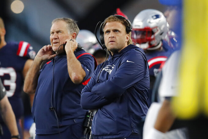 New England Patriots outside linebackers coach Steve Belichick, right, watches a replay with his father, head coach Bill Belichick during the first half of an NFL football game against the Dallas Cowboys, Sunday, Oct. 17, 2021, in Foxborough, Mass. (AP Photo/Michael Dwyer)