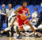Wisconsin's Khalil Iverson (21) takes off with the ball after a steal against Penn State during first half action of an NCAA college basketball game in State College, Pa. Sunday, Jan. 6, 2019. (AP Photo/Chris Knight)