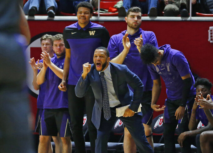 The Washington bench celebrates during the second half of the team's NCAA college basketball game against Utah on Thursday, Jan. 10, 2019, in Salt Lake City. (AP Photo/Rick Bowmer)