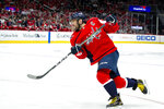 Washington Capitals left wing Alex Ovechkin (8), of Russia, shoots the puck during the third period of an NHL hockey game Sunday, Nov. 3, 2019, in Washington. The Capitals won 4-2. (AP Photo/Al Drago)
