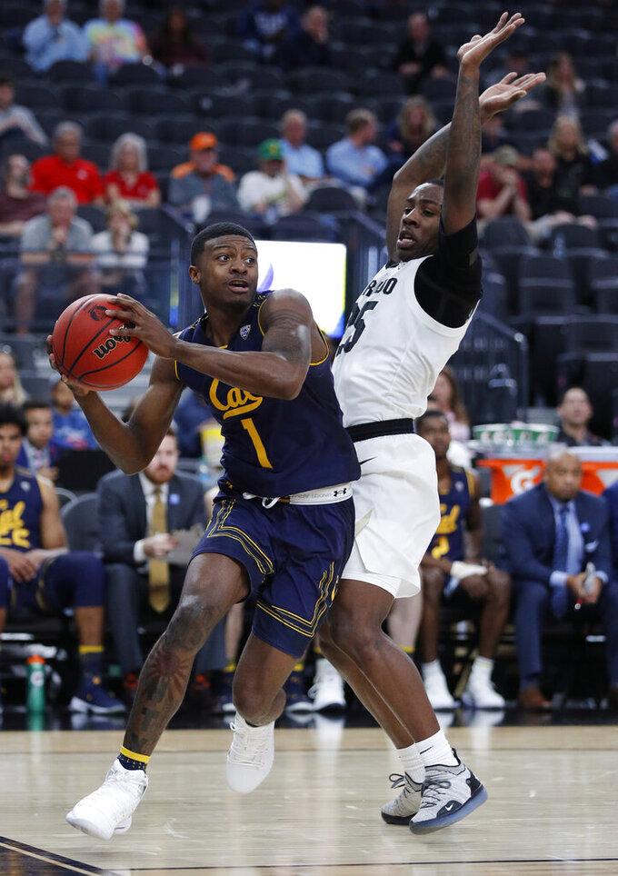 California's Darius McNeill drives around Colorado's McKinley Wright IV during the second half of an NCAA college basketball game in the first round of the Pac-12 men's tournament Wednesday, March 13, 2019, in Las Vegas. (AP Photo/John Locher)