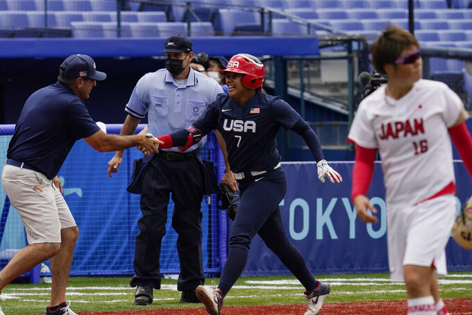 United States' Kelsey Stewart (7) celebrates her game winning home run against Japan as she runs behind Japan pitcher Yamato Fujita (16) in the seventh inning of a softball game at the 2020 Summer Olympics, Monday, July 26, 2021, in Yokohama, Japan. (AP Photo/Sue Ogrocki)