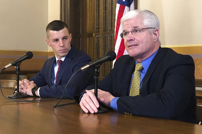 FILE - In this Jan. 30, 2020, file photo, Senate Majority Leader Mike Shirkey, R-Clarklake, right, and House Speaker Lee Chatfield, R-Levering, left, speak at the Michigan Capitol in Lansing, Mich. Michigan lawmakers moved Wednesday, Sept. 23, 2020, to pass a $62.7 billion budget that would keep spending flat thanks to a federal rescue and avoid major cuts that had been feared due to the coronavirus pandemic. The plan was unveiled in the morning and was expected to win final approval by day's end before going to Gov. Whitmer for her signature. (AP Photo/David Eggert, File)