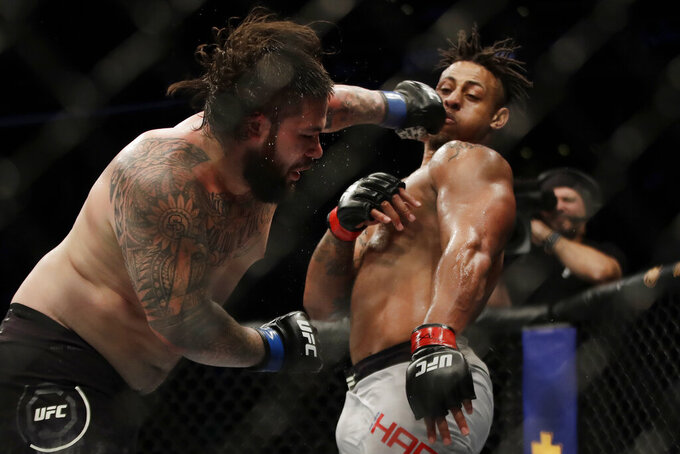 Ben Sosoli, left, lands a punch to Greg Hardy during a heavyweight mixed martial arts bout Friday, Oct. 18, 2019, at UFC Fight Night in Boston. (AP Photo/Elise Amendola)