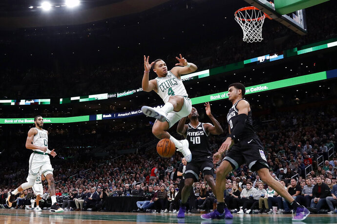 Boston Celtics' Carsen Edwards has the ball knocked away from him by Sacramento Kings' Trevor Ariza during the second quarter of an NBA basketball game Monday, Nov. 25, 2019, in Boston. (AP Photo/Winslow Townson)