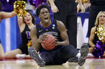 Washington's Noah Dickerson (15) reacts after getting possession of the ball against Utah State in the first half during a first round men's college basketball game in the NCAA Tournament in Columbus, Ohio, Friday, March 22, 2019. (AP Photo/Tony Dejak)