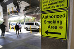 A sign directs patients and staff workers to a smoking shack outside the main entrance of the West Roxbury campus of the Veterans Affairs Medical Center in Boston, Monday, Sept. 30, 2019. The VA is set to ban smoking at all its grounds nationwide starting Oct. 1, a welcome move by health-conscious veterans but not by others who enjoy a smoke between appointments. (AP Photo/Charles Krupa)