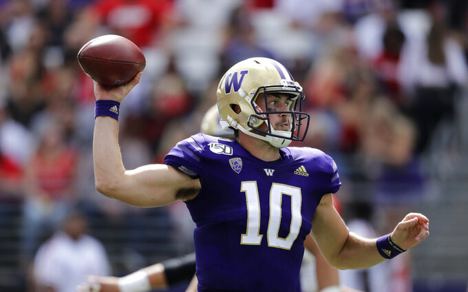 Washington quarterback Jacob Eason passes against Eastern Washington in the first half of an NCAA college football game Saturday, Aug. 31, 2019, in Seattle. (AP Photo/Elaine Thompson)