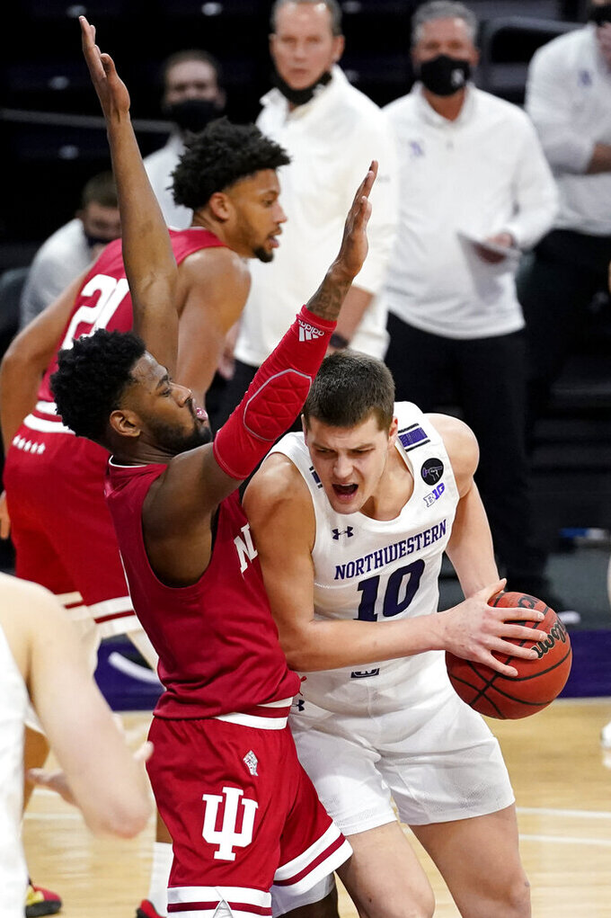 Indiana guard Al Durham, left, defends against Northwestern forward Miller Kopp during the second half of an NCAA college basketball game in Evanston, Ill., Wednesday, Feb. 10, 2021. (AP Photo/Nam Y. Huh)