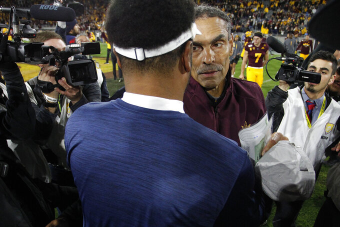 Arizona State head coach Herm Edwards meets Arizona coach Kevin Sumlin at the center of the field after his team defeated Arizona 24-14 in an NCAA college football game, Saturday, Nov. 30, 2019, in Tempe, Ariz. (AP Photo/Darryl Webb)
