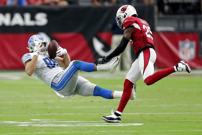 Detroit Lions tight end T.J. Hockenson (88) makes a catch as Arizona Cardinals defensive back Chris Jones (25) defends during the second half of an NFL football game, Sunday, Sept. 8, 2019, in Glendale, Ariz. (AP Photo/Darryl Webb)