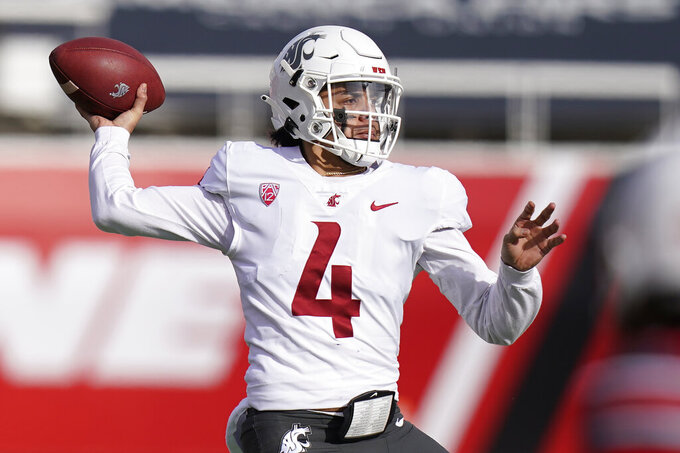 Washington State quarterback Jayden de Laura (4) throws against Utah during the first half of an NCAA college football game Saturday, Dec. 19, 2020, in Salt Lake City. (AP Photo/Rick Bowmer)