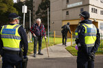 Police stand outside public housing towers that are a hotspot for COVID-19 in Melbourne Friday, July 10, 2020. Australia's Victoria state reported the new daily record of coronavirus cases. (Daniel Pockett/AAP Image via AP)
