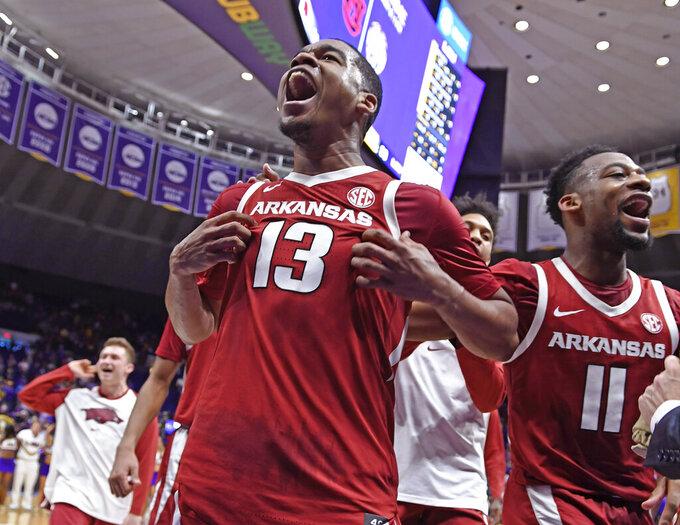 Arkansas guard Mason Jones (13) celebrates with guard Keyshawn Embery-Simpson (11) after an NCAA college basketball game against LSU on Saturday, Feb. 2, 2019, in Baton Rouge, La. Arkansas won 90-89 on Jones' shot. (AP Photo/Bill Feig)