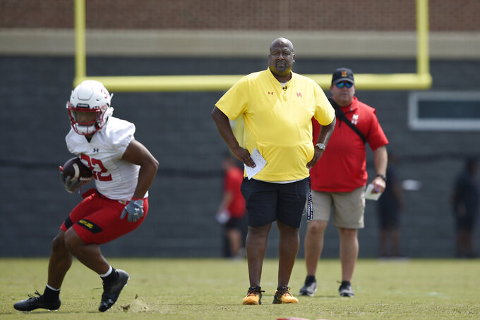 Maryland football head coach Michael Locksley watches during NCAA college football practice, Friday, Aug. 6, 2021, in College Park, Md.(AP Photo/Gail Burton)