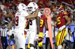 Stanford wide receiver Connor Wedington (5) celebrates his touchdown catch with Osiris St. Brown (9) during the first half of the team's NCAA college football game against Southern California on Saturday, Sept. 7, 2019, in Los Angeles. (AP Photo/Marcio Jose Sanchez)
