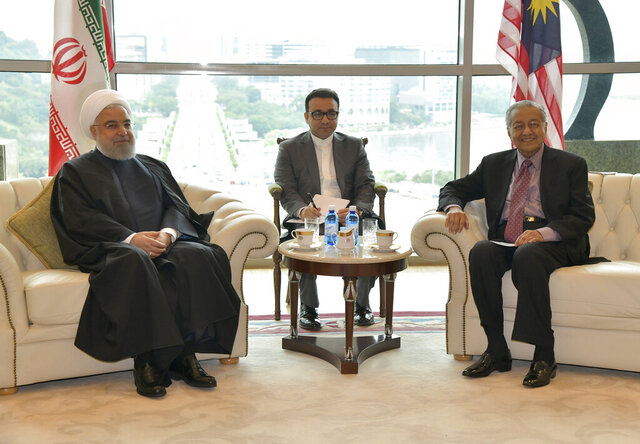 In this photo released by Malaysia's Department of Information, Malaysia's Prime Minister Mahathir Mohamad, right, and Iran's President Hassan Rouhani, pose for a photo ahead of their meeting in Putrajaya, Malaysia, Wednesday, Dec. 18, 2019.(Malaysia's Department of Information via AP)