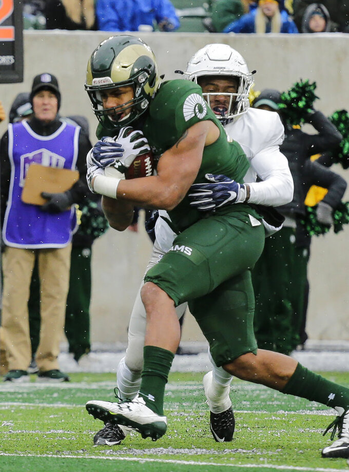 Colorado State running back Izzy Matthews (24) runs for a touchdown against Utah State cornerback DJ Williams (7) during the first half of an NCAA football game Saturday, Nov. 17, 2018, in Fort Collins, Colo. (AP Photo/Jack Dempsey)