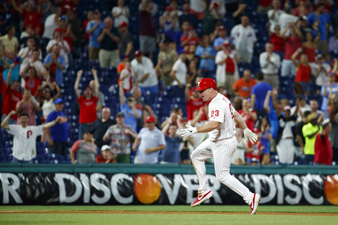 Philadelphia Phillies' Jay Bruce celebrates after driving in the winning run with a double off New York Mets relief pitcher Stephen Nogosek during the 10th inning of a baseball game Wednesday, June 26, 2019, in Philadelphia. Philadelphia won 5-4. (AP Photo/Matt Slocum)