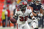 Tampa Bay Buccaneers safety Mike Edwards (32) looks back after intercepting a pass by Atlanta Falcons quarterback Matt Ryan (2) and returning it for a score during the second half of an NFL football game Sunday, Sept. 19, 2021, in Tampa, Fla. (AP Photo/Jason Behnken)