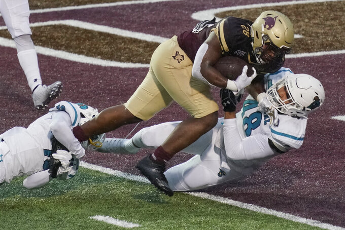 Texas State's Jahmyl Jeter (28) runs into the end zone against Coastal Carolina's Davon Bomar (48) during the second half of an NCAA college football game in San Marcos, Texas, Saturday, Nov. 28, 2020. (AP Photo/Chuck Burton)