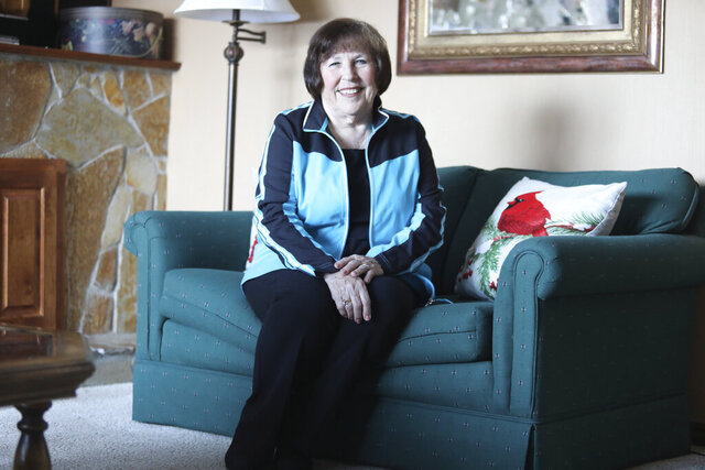 Mary Spencer is photographed at her home on Dec. 29, 2020 in Eden, Utah. Spencer was 19 years old when she dropped out of college. Now, over 61 years later, the 80-year-old has earned her bachelor's degree. In a virtual Brigham Young University-Idaho commencement held earlier this month, Spencer was awarded a Bachelor of Science in marriage and family studies. (Emily Anderson/Standard-Examiner via AP)