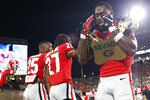 Georgia defensive back J.R. Reed (20) celebrates after getting a win in a NCAA football game between Georgia and Notre Dame in Athens, Ga., on Saturday, Sept. 21, 2019. Georgia won 23-17. [Photo/Joshua L. Jones, Athens Banner-Herald]/Athens Banner-Herald via AP)NCAA college football game Saturday, Sept. 21, 2019, in Athens, Ga. (Joshua L. Jones/Athens Banner-Herald via AP)