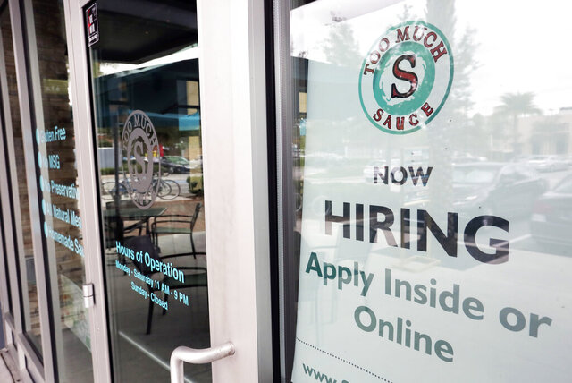 FILE - In this Nov. 4, 2019, file photo a job posting is displayed near the entrance outside a restaurant in Orlando, Fla. Although many small businesses struggle to find staffers to fill their open positions, many entrepreneurs with recently launched companies intend to create jobs within a few years. (AP Photo/John Raoux, File)