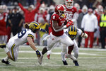Indiana running back Stevie Scott III (8) is tackled by Michigan's Jordan Glasgow (29) and linebacker Khaleke Hudson (7) during the first half of an NCAA college football game, Saturday, Nov. 23, 2019, in Bloomington, Ind. (AP Photo/Darron Cummings)