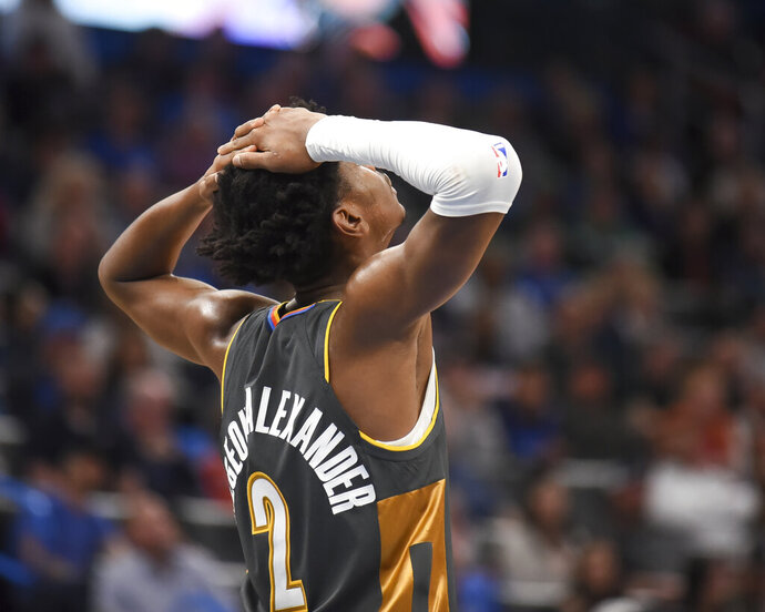 Oklahoma City Thunder guard Shai Gilgeous-Alexander reacts after the Thunder lose to the Boston Celtics in an NBA basketball game, Sunday, Feb. 9, 2020, in Oklahoma City. (AP Photo/Kyle Phillips)