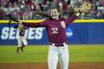 Florida State pitcher Kathryn Sandercock (32) celebrates after Florida State defeated Oklahoma 8-4 in the first game of the NCAA Women's College World Series softball championship series Tuesday, June 8, 2021, in Oklahoma City. (AP Photo/Sue Ogrocki)