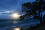 The sun rises as Tropical Storm Olivia approaches Oahu, Wednesday, Sept. 12, 2018 near Kaaawa, Hawaii. (AP Photo/Caleb Jones)