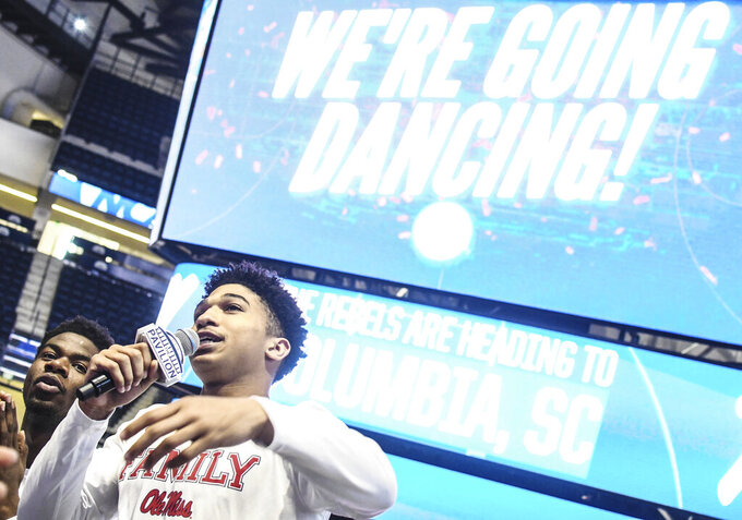 Mississippi guard Breein Tyree, right, with guard Terence Davis (3), address fans gathered to watch the broadcast of the NCAA Division I men's basketball tournament selection show in Oxford, Miss., Sunday, March 17, 2019. (Bruce Newman/The Oxford Eagle via AP)
