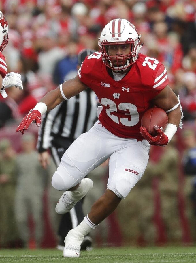 FILE - In this Nov. 3, 2018, file photo, Wisconsin's Jonathan Taylor runs during the first half against Rutgers, in Madison, Wis. Taylor was named to the 2018 AP All-America NCAA college football team, Monday, Dec. 10, 2018. (AP Photo/Morry Gash, File)
